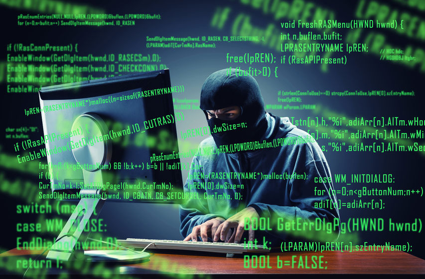 website security tips - hacker in mask stealing information from a computer.